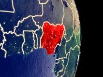 Nigeria auf Nachterde stockbild