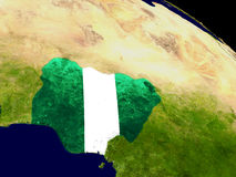 Nigeria with flag on Earth Stock Image