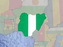 Nigeria with flag on globe Royalty Free Stock Photography