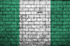Nigeria flag is painted onto an old brick wall stock photography