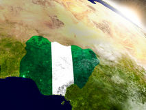Nigeria with flag in rising sun Royalty Free Stock Images