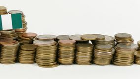 Nigeria flag with stack of money coins. Nigeria flag waving with stack of money coins stock footage
