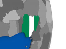 Nigeria on globe with flag Stock Image