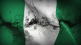 Nigeria grunge dirty flag waving on wind. Nigerian background fullscreen grease flag blowing on wind. Realistic filth fabric texture on windy day Royalty Free Stock Photography