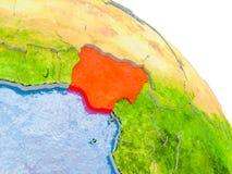 Nigeria im roten Modell von Erde Stockfotografie