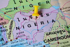 Nigeria map. Macro shot of nigeria map with push pin royalty free stock photo