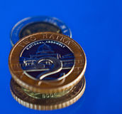 Nigeria Naira coins. Closeup of Nigerian Naira coins against blue background royalty free stock photo