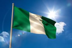 Nigeria national flag on flagpole Royalty Free Stock Photography