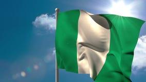 Nigeria national flag waving on flagpole stock footage
