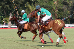 Nigeria polo captain. Right,Muhamad Babaginda Nigerian Polo team captain try to clear the ball during match againts South Africa at FIP Polo World Cup Stock Images