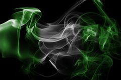 Nigeria smoke flag. Isolated on a black background stock image