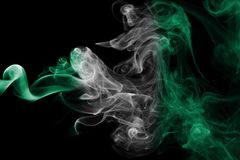 Nigeria smoke flag. Isolated on a black background royalty free stock photography
