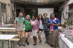Nigerian and Croatian football fans Stock Photo