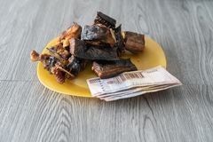 Nigerian dried roasted fish with Naira notes. To buy it royalty free stock photos
