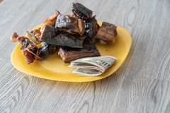 Nigerian dried roasted fish with Naira notes. To buy it royalty free stock photography