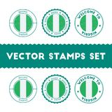 Nigerian flag rubber stamps set. National flags grunge stamps. Country round badges collection Royalty Free Stock Photography