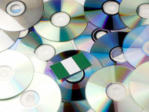 Nigerian flag on top of CD and DVD pile isolated on white Stock Photography