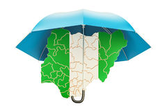 Nigerian map under umbrella. Security and protect or insurance c Stock Images