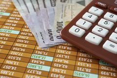 Nigerian Naira Notes with Calculator on Spreadsheet stock image