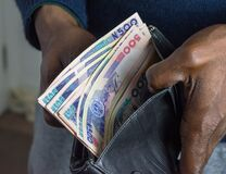 Free Nigerian Naira: Wealthy Businessman With Money In Wallet. Royalty Free Stock Photography - 185058627