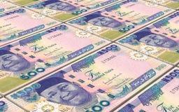 Nigerian nairas bills stacks background. Royalty Free Stock Image