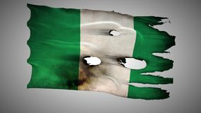 Nigerian perforated, burned, grunge waving flag loop alpha stock video