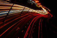 Nigh city highway. Headlights on the road Royalty Free Stock Images