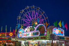 Nigh on the Midway. A colorful night on the midway at the county fair royalty free stock photography