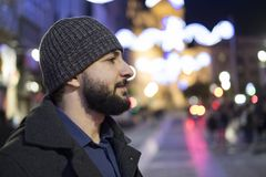 Nigh scene portrait of bearded man with winter nigh lights in ba. Ckground Stock Photography