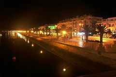 Night. Lanterns are reflected in water. Night quay in resort city Stock Photo