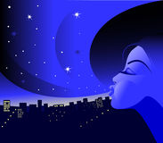 Night. Above night city the girl the magician issues stars Stock Photo