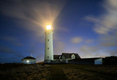Night. Lighthouse one night with drifting clouds Stock Images