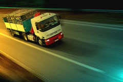 By night. Truck on the road again Stock Image