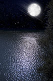 Night. Sky with full moon and reflection over water royalty free stock photo
