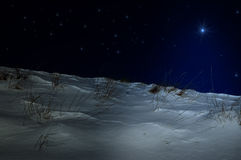 Night. Winter night with blue star Royalty Free Stock Photos