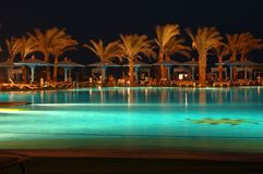 Night. Beauty made by water and palm  - hotel resort. /Egypt Royalty Free Stock Image