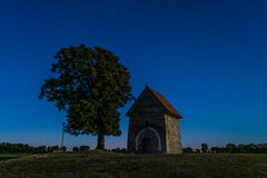Night abandoned chapel under the stars in the night sky Royalty Free Stock Photo