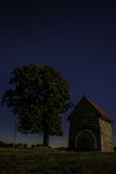Night abandoned chapel under the stars in the night sky Stock Image