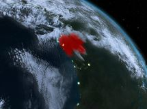Gabon at night from orbit. Night above Gabon highlighted in red on model of planet Earth in space. 3D illustration. Elements of this image furnished by NASA Royalty Free Stock Photography