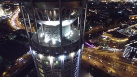Night aerial flight over center of Moscow. House of music hall. Modern Glass buildings. Night road traffic. stock footage