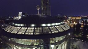 Night aerial flight over center of Moscow. House of music hall. Modern Glass buildings. Night road traffic. stock video footage