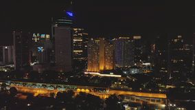 Night aerial survey of the city of Jakarta with skyscrapers.