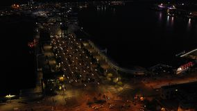 Night aerial video of port vellof Barcelona and road with car traffic. Camera moving from Roundabout up. Video footage stock video footage