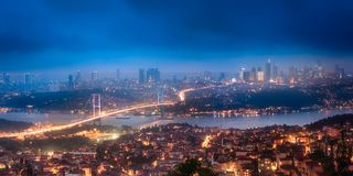 Night aerial view of Bosphorus bridge and panorama of Istanbul. Turkey royalty free stock image