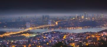Night aerial view of Bosphorus bridge and panorama of Istanbul stock images