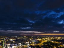 Night aerial view of downtown. Urban architectures with illumination under dramatic sky. Minsk, Belarus – August 18, 2018: Night aerial view of downtown royalty free stock photos
