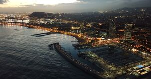 Night aerial view from drones of coast in Barcelona with sea and building
