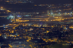 Night aerial view of the European metropolis with many city ligh Stock Photos