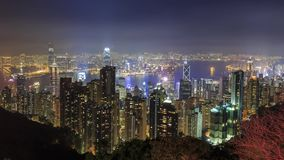 Night aerial view of the Hong Kong skyline with Victoria harbor. Night aerial view of the Hong Kong city skyline with Victoria harbor from Victoria Peak at China stock footage