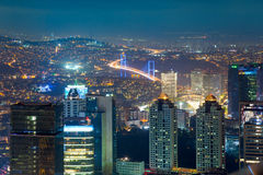 Night Aerial view of the illuminated city, skyscrapers and bridg Stock Photography